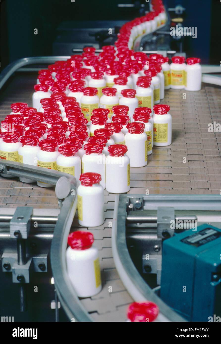 Pharmaceutical production line of bottled Tylenol painkiller tablets - Stock Image