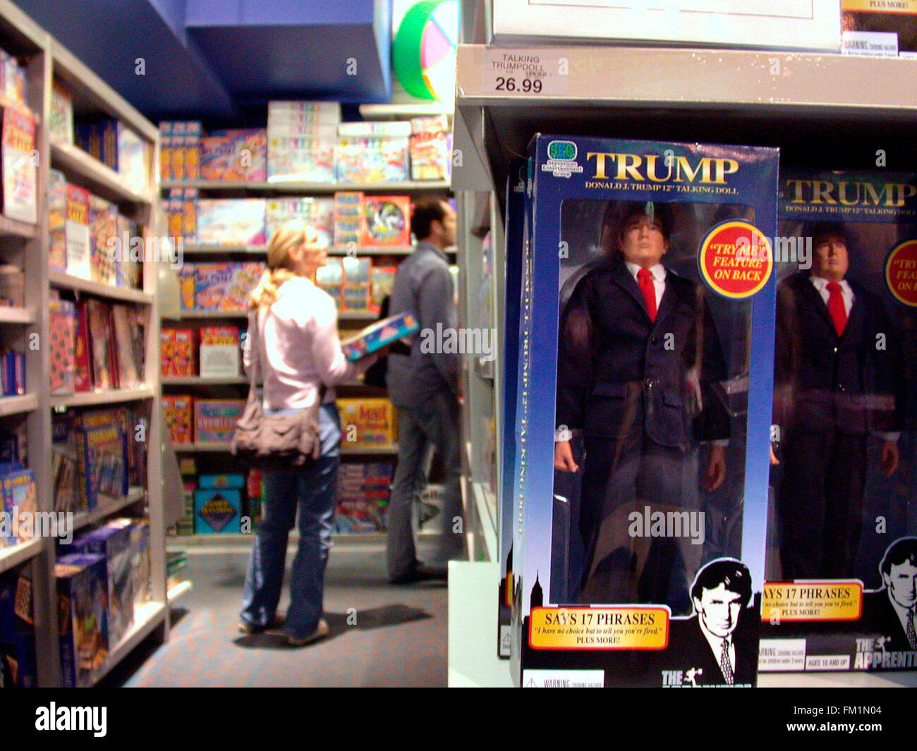 The new Donald Trump doll on display at Toys R Us in Times Square on September 30, 2004.  The 12 inch doll spews - Stock Image