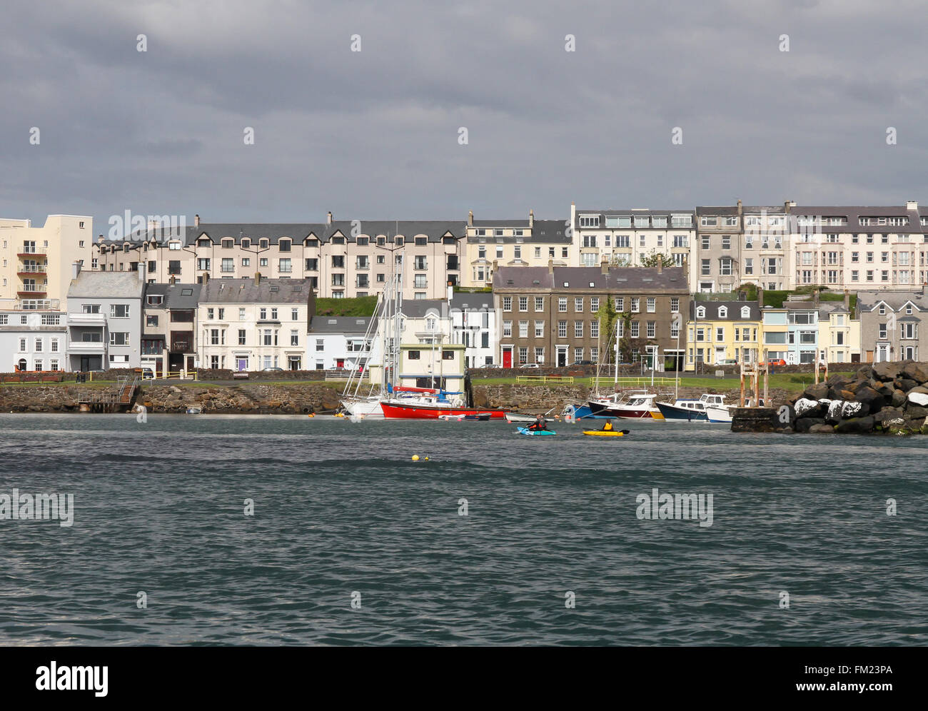 Houses and accommodation overlooking boats in Portrush Harbour at Portrush, County Antrim, Northern Ireland Stock Photo