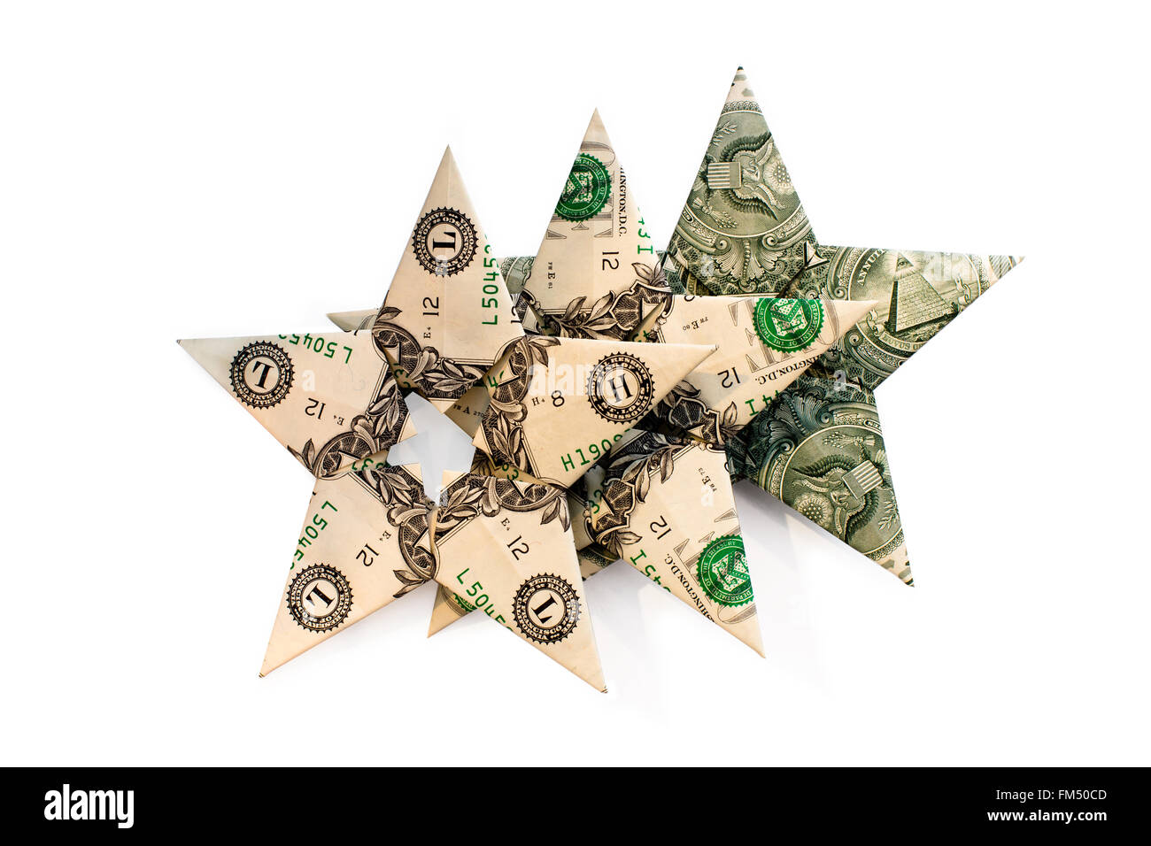 Three different variants of cash dollar bills stacked in the shape of the stars folded in a row one by one as stars Stock Photo