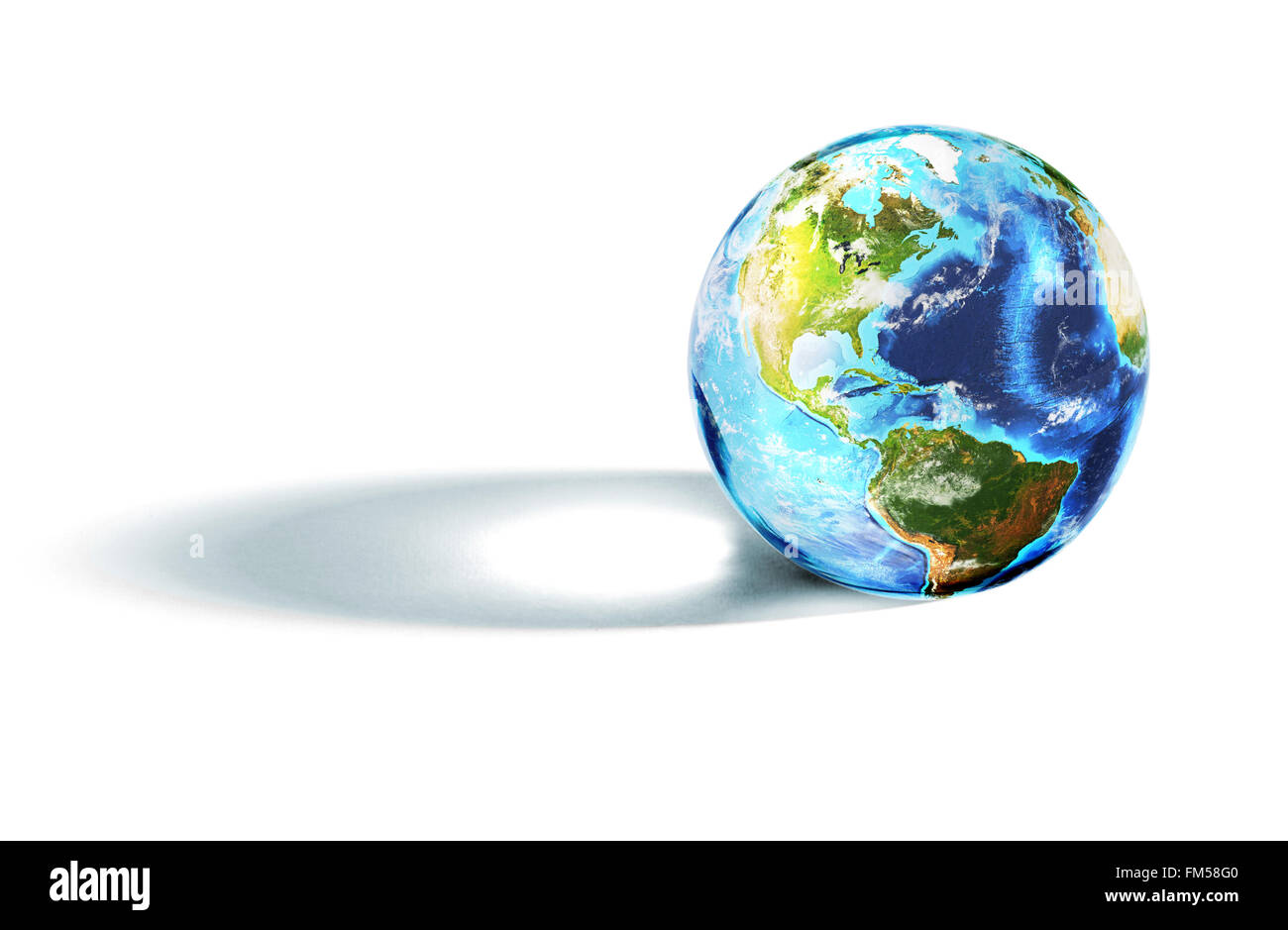 Colorful world globe representing the Earth casting an artistic side shadow - Stock Image