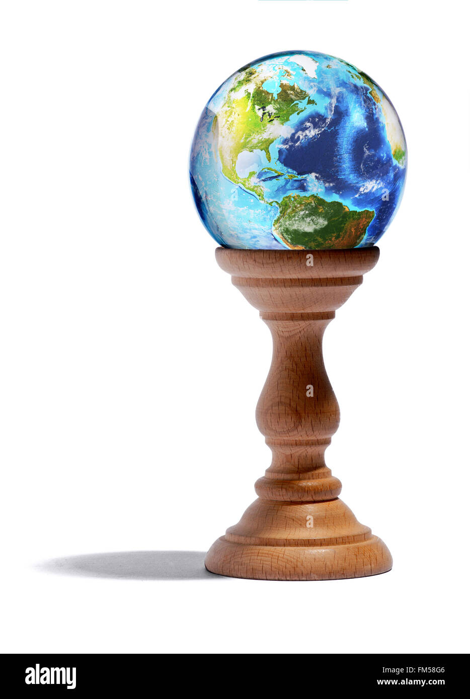 Fortuneteller glass globe showing the continents and oceans of the Earth - Stock Image