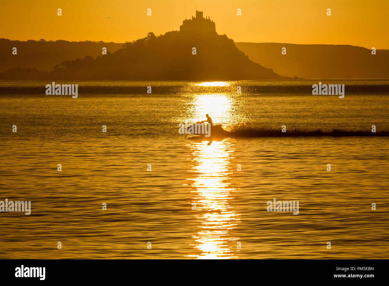 Penzance, Cornwall, UK. 11th March 2016. UK Weather. Sunrise at Penzance,  with local Jetskiers enjoying the morning Stock Photo