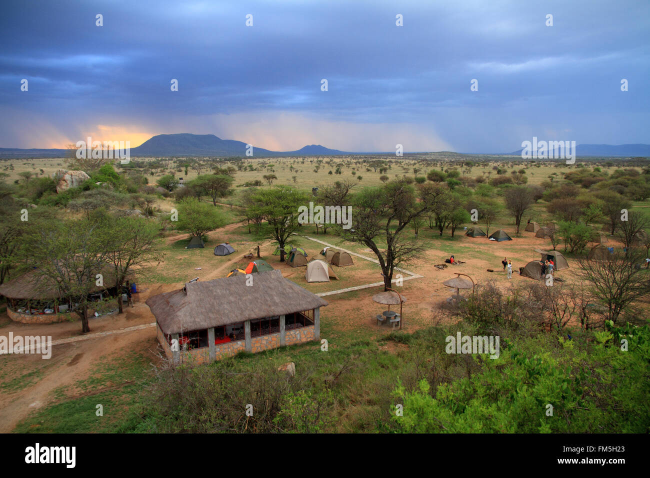 A safari camp in the serengeti as a storm moves in - Stock Image