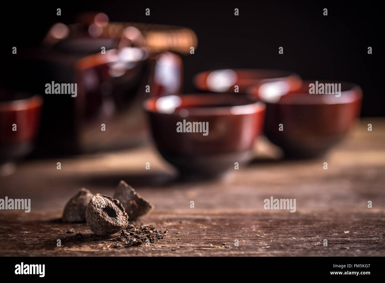 Compressed pu-erh chinese tea on rustic wooden background Stock Photo
