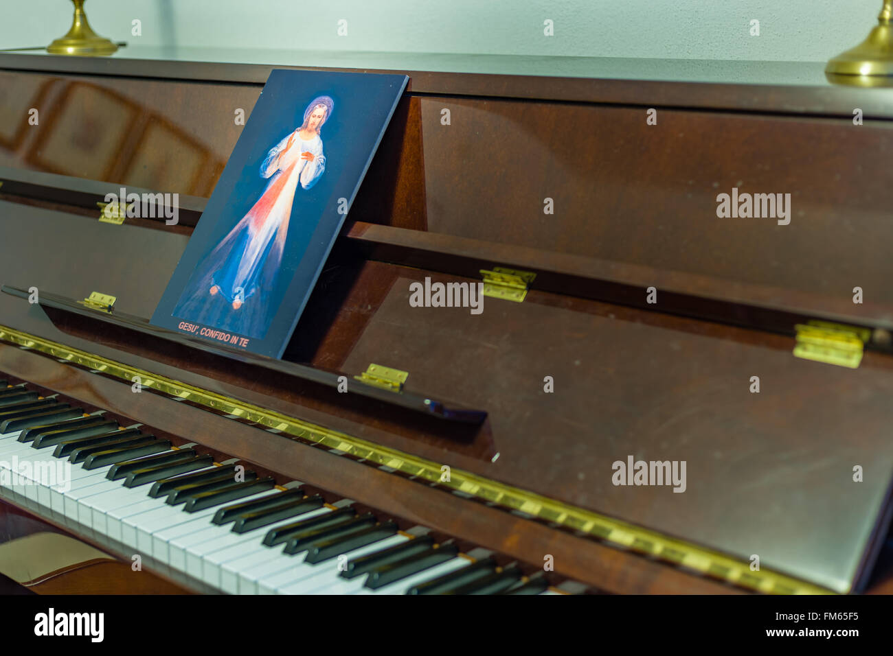 the Merciful Jesus icon on a piano in place of scores