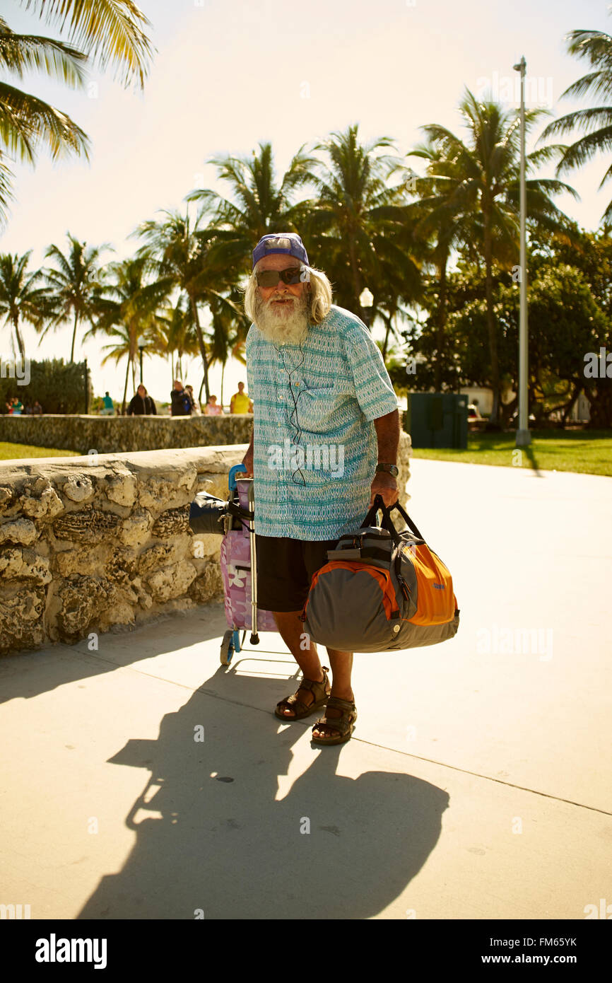 Old Man With Beard Carrying A Bag And Pulls A Hack Porsche Stock Photo Alamy