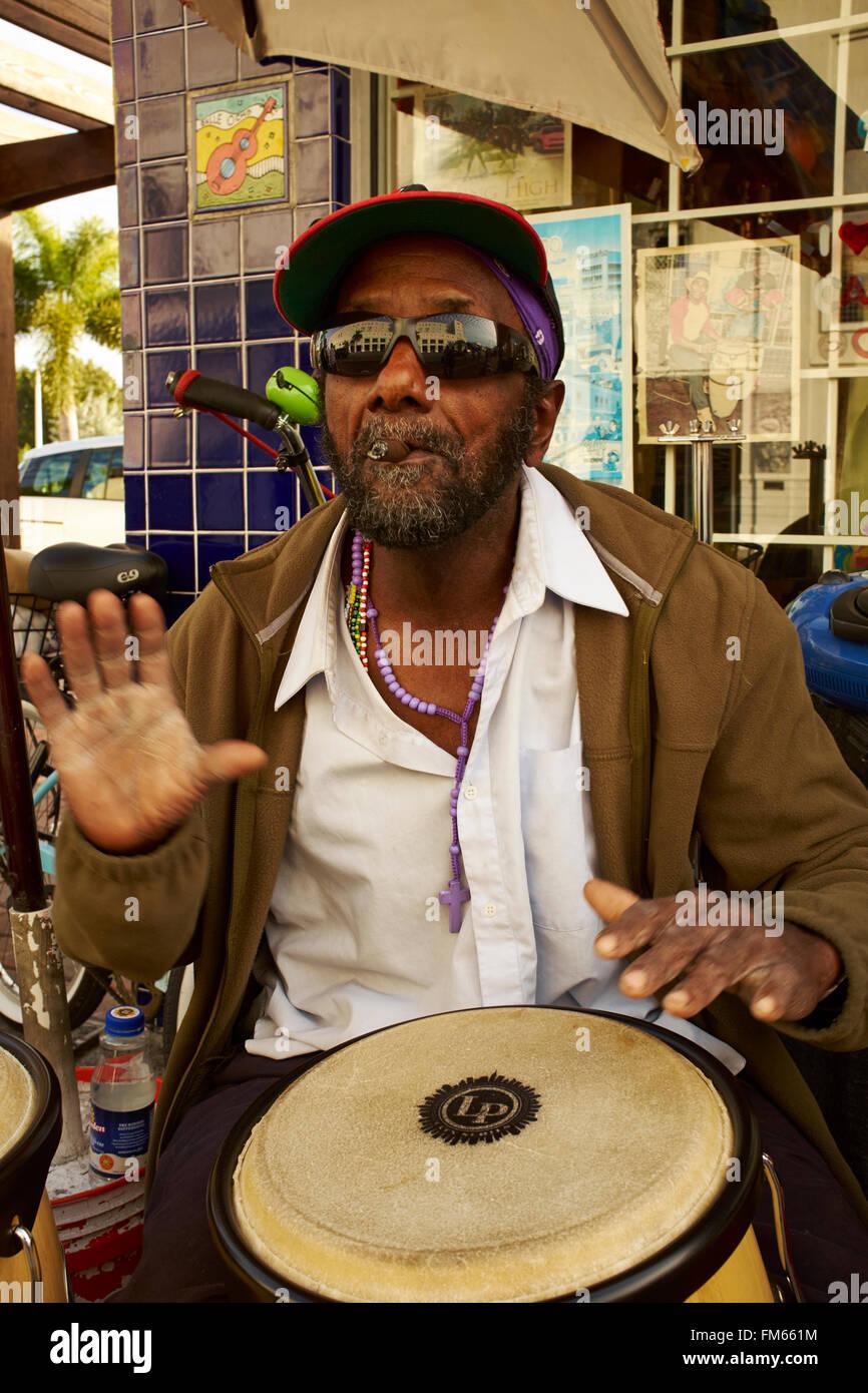 Black American man playing drum - Stock Image