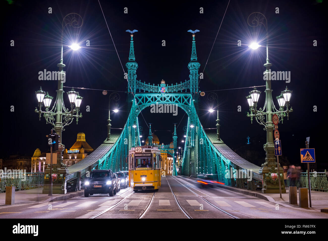 Liberty bridge with cars and tram in Budapest Hungary - Stock Image