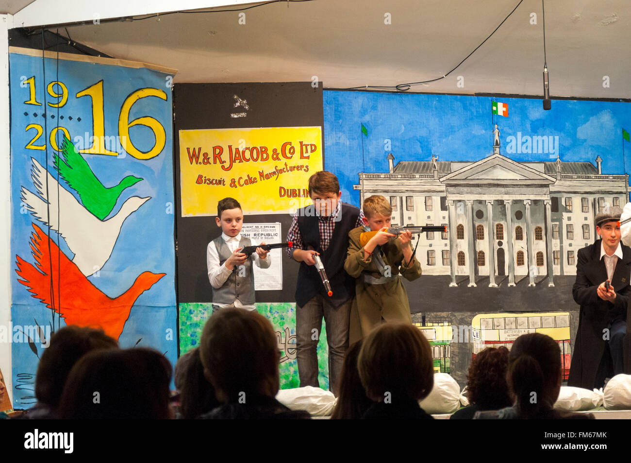 School children in Dungloe, County Donegal, Ireland perform a play entitled 'Remembering Easter 1916' as - Stock Image