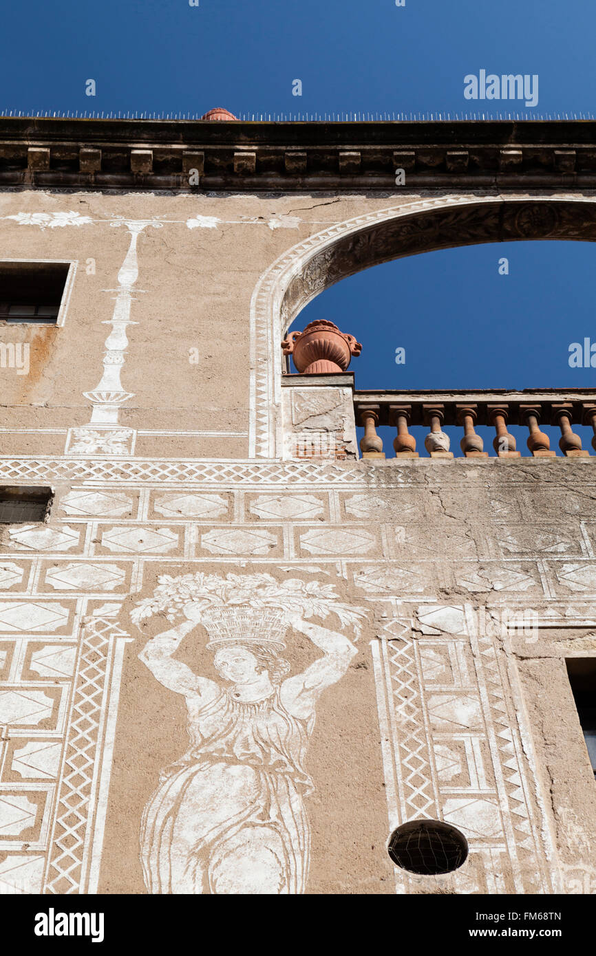 A view from below a Mural on wall of medieval mansion, in Barcelona. - Stock Image