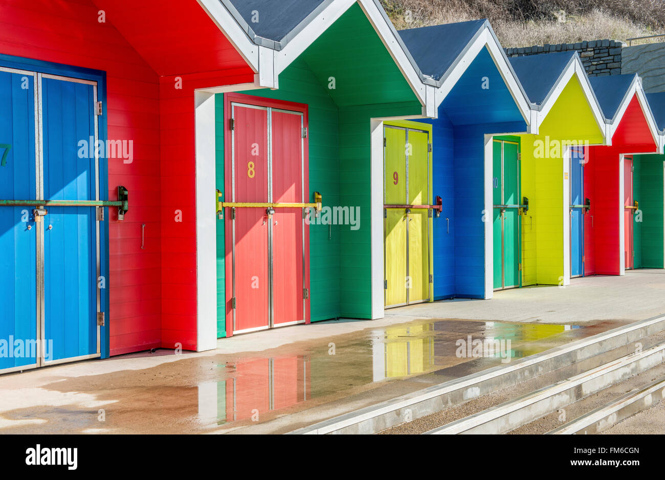 Colourful beach huts at Whitmore Bay on Barry Island south Wales Stock Photo
