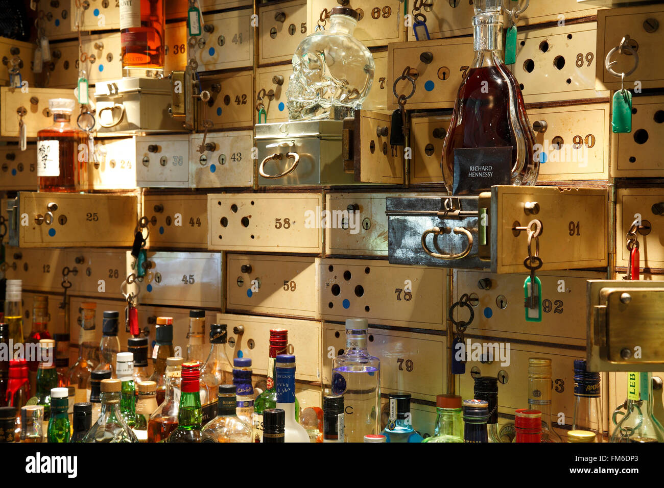 Bottle of spirits and safety deposit boxes. - Stock Image