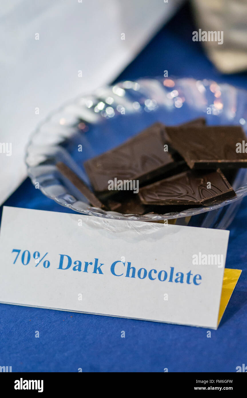 Samples of 70% dark chocolate squares. Stock Photo