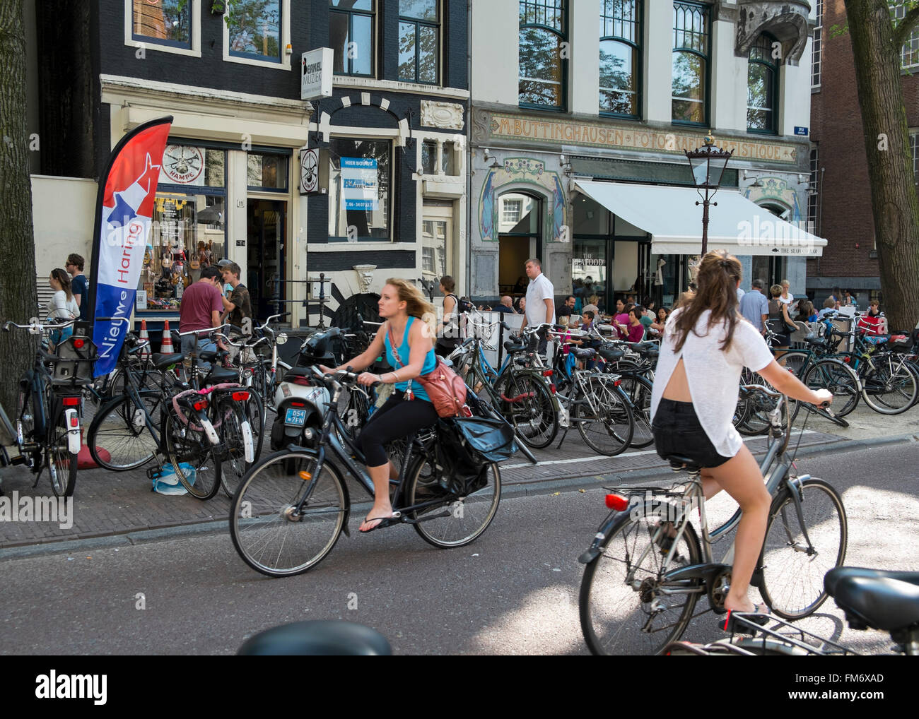 Women cycling in Amsterdam. - Stock Image