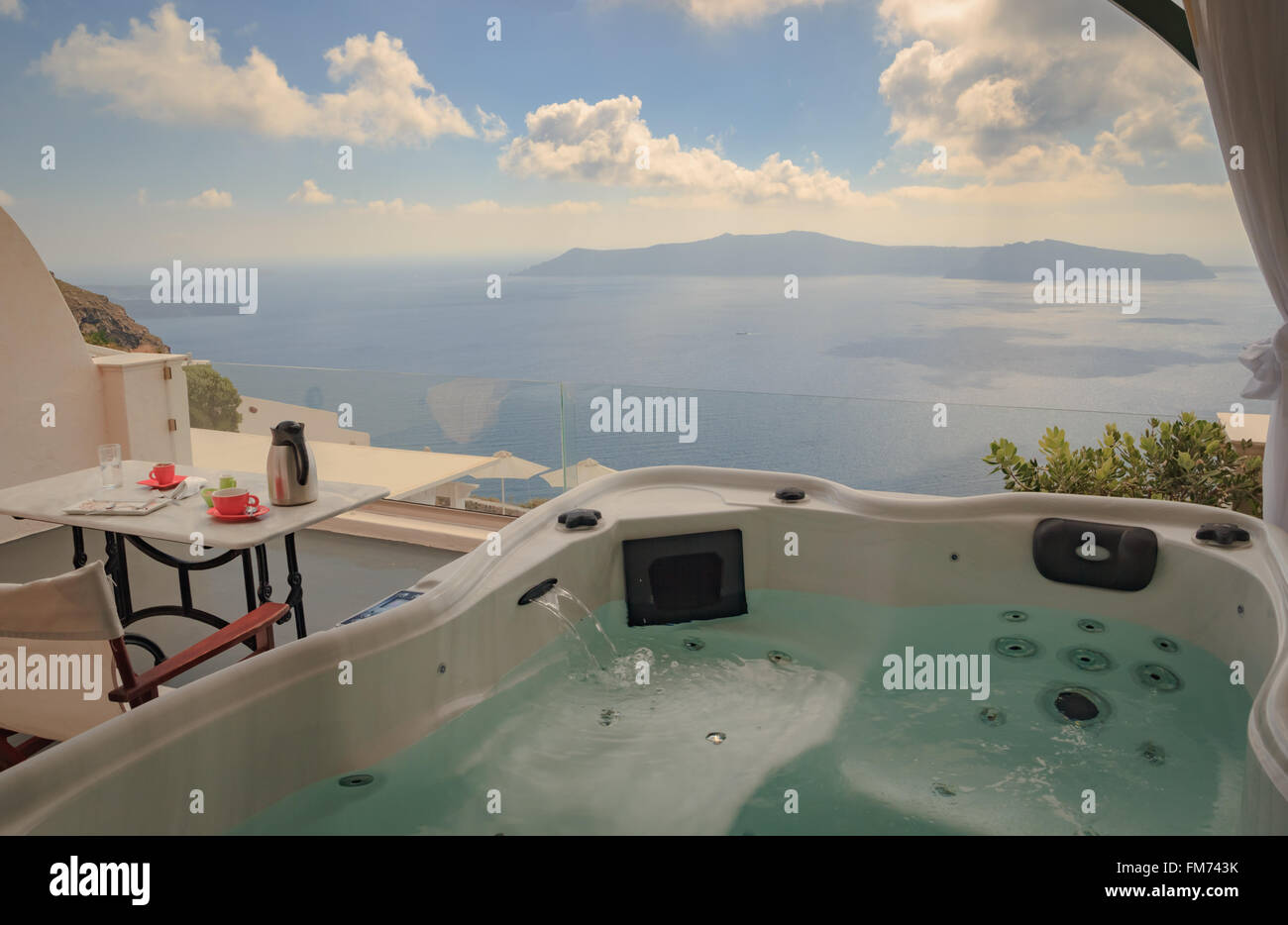 View from hot tub on balcony overlooking the Aegean sea on Santorini Stock Photo