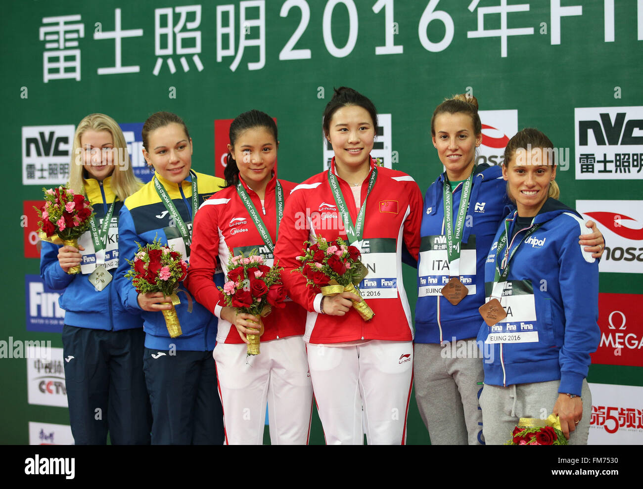 Beijing, China. 11th Mar, 2016. Gold medalists Chinese He Zi (3rd L) and Wang Han pose with silver medalists Ukrainian - Stock Image