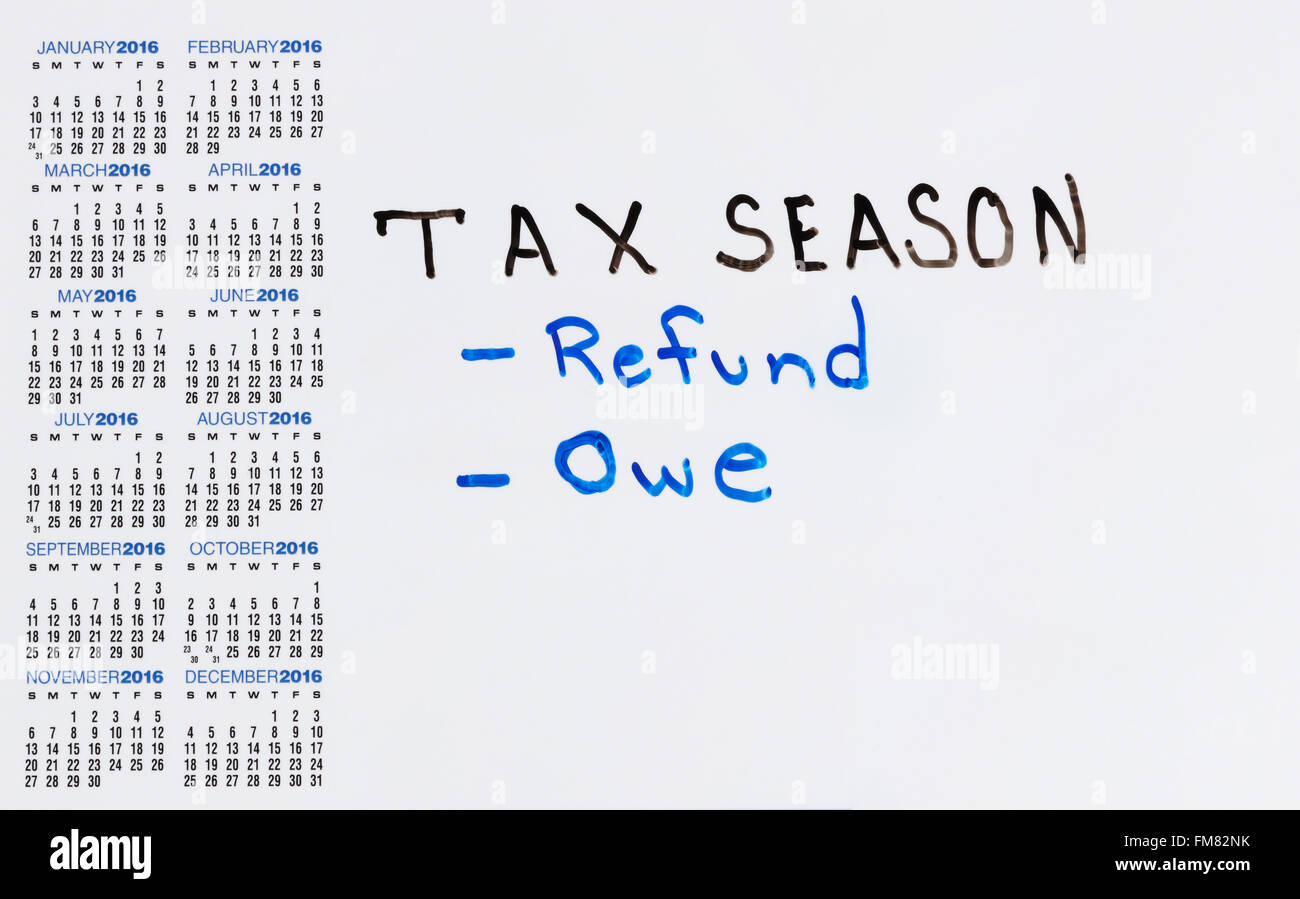 Calendar on white board with tax concept for either a refund or owe. - Stock Image