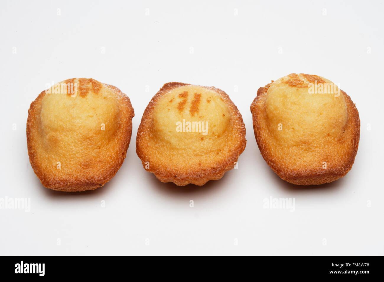 Three French madeleine cakes, close-up - Stock Image