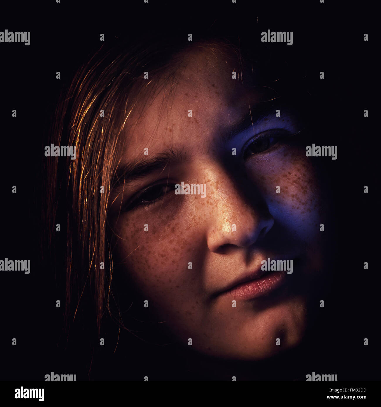 Portrait of a young girl with face expression of unhappy feelings. - Stock Image
