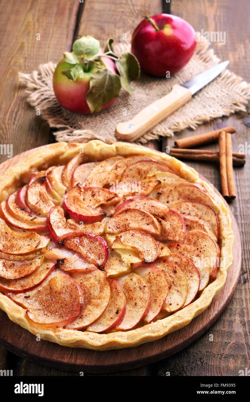 Apple pie on wooden table - Stock Image