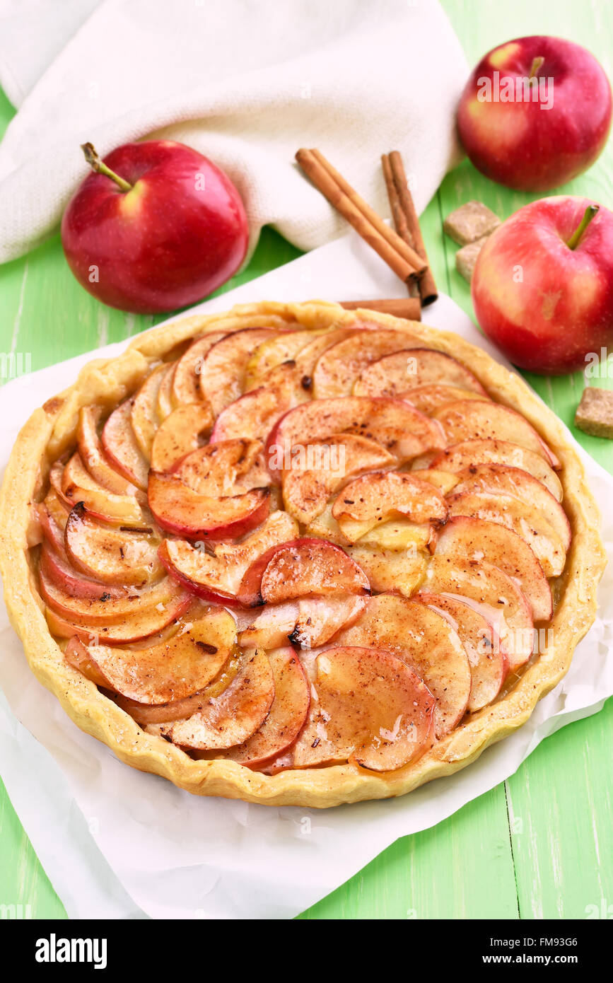 Apple pie, fresh fruits and cinnamon sticks - Stock Image