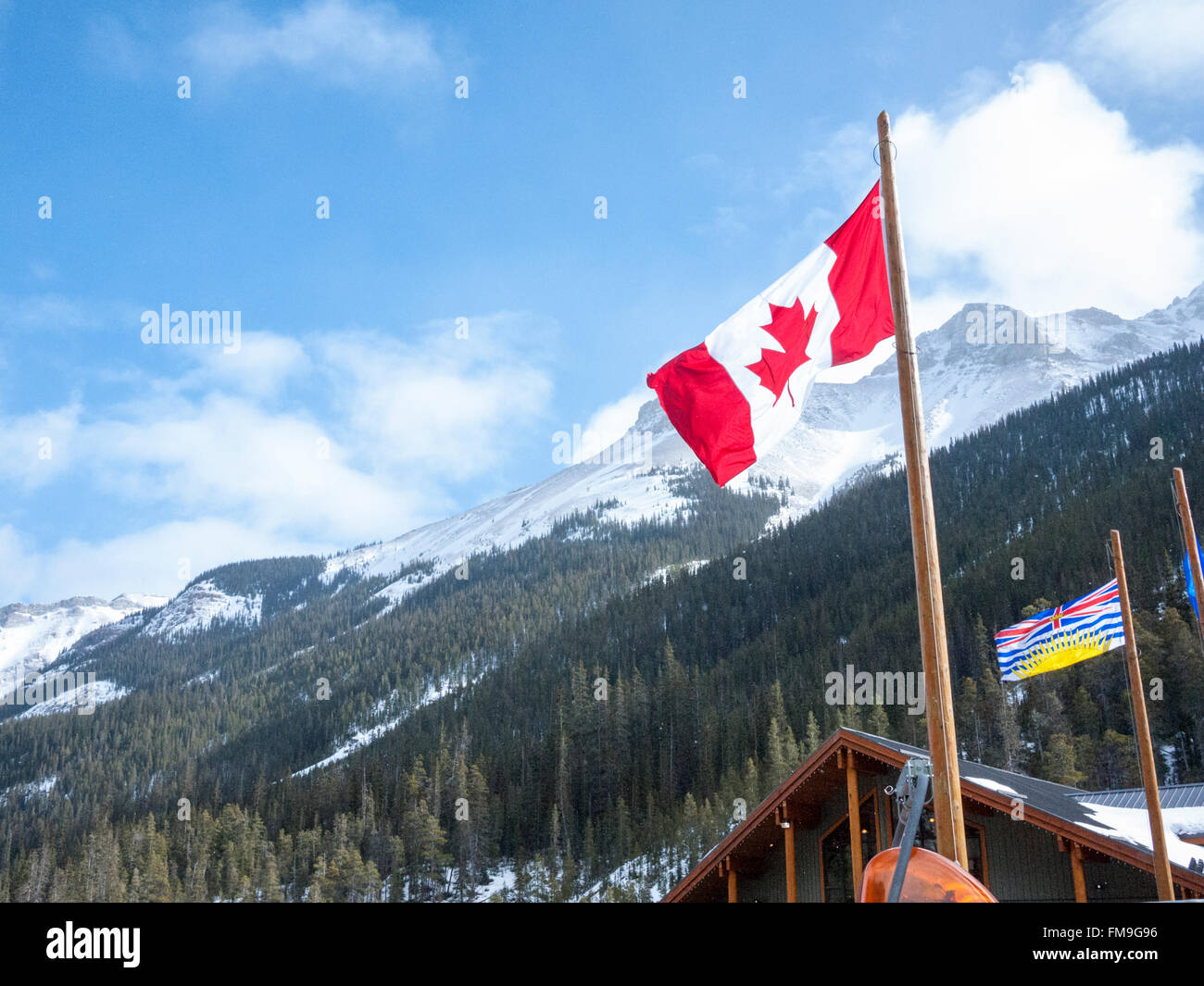 The Canadian Maple Leaf flag flying at the Sunshine Village Ski resort at Banff in the Rockies Canada - Stock Image