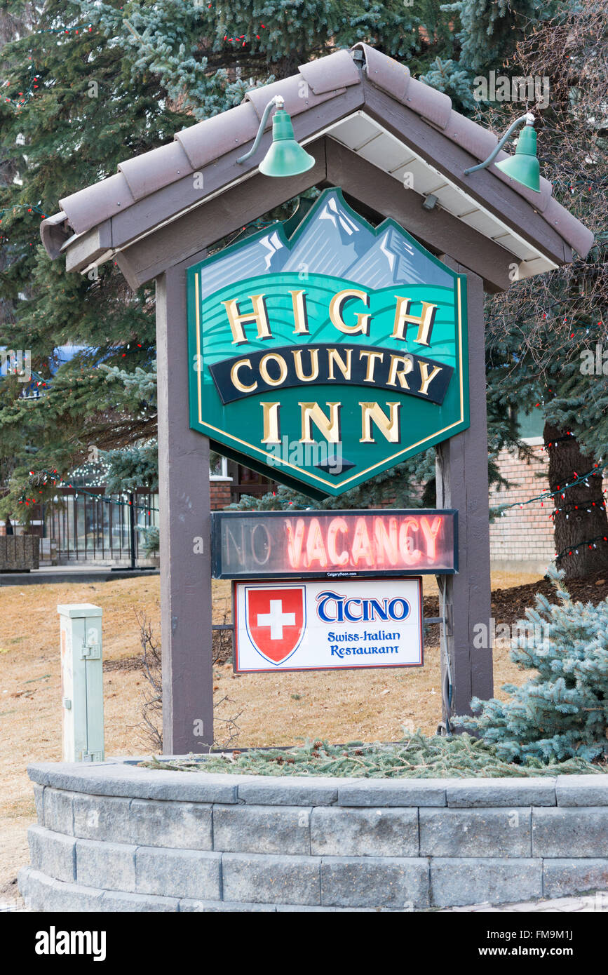 The sign for the High Country Inn Banff Canada in winter - Stock Image