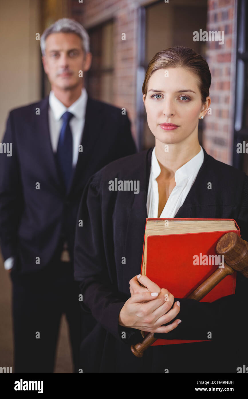 Female lawyer with male colleague in background - Stock Image
