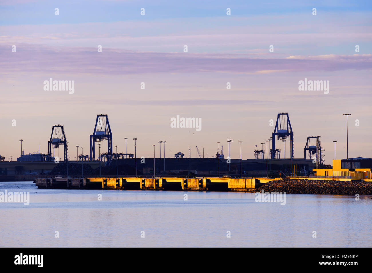 Industrial landscape with cranes in Getxo at sunset - Stock Image