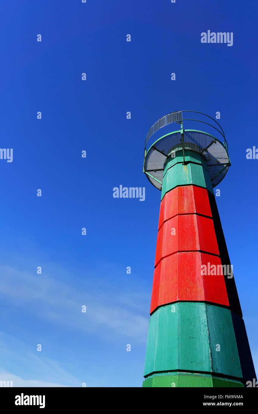 small lighthouse in Santurtzi against blue sky - Stock Image