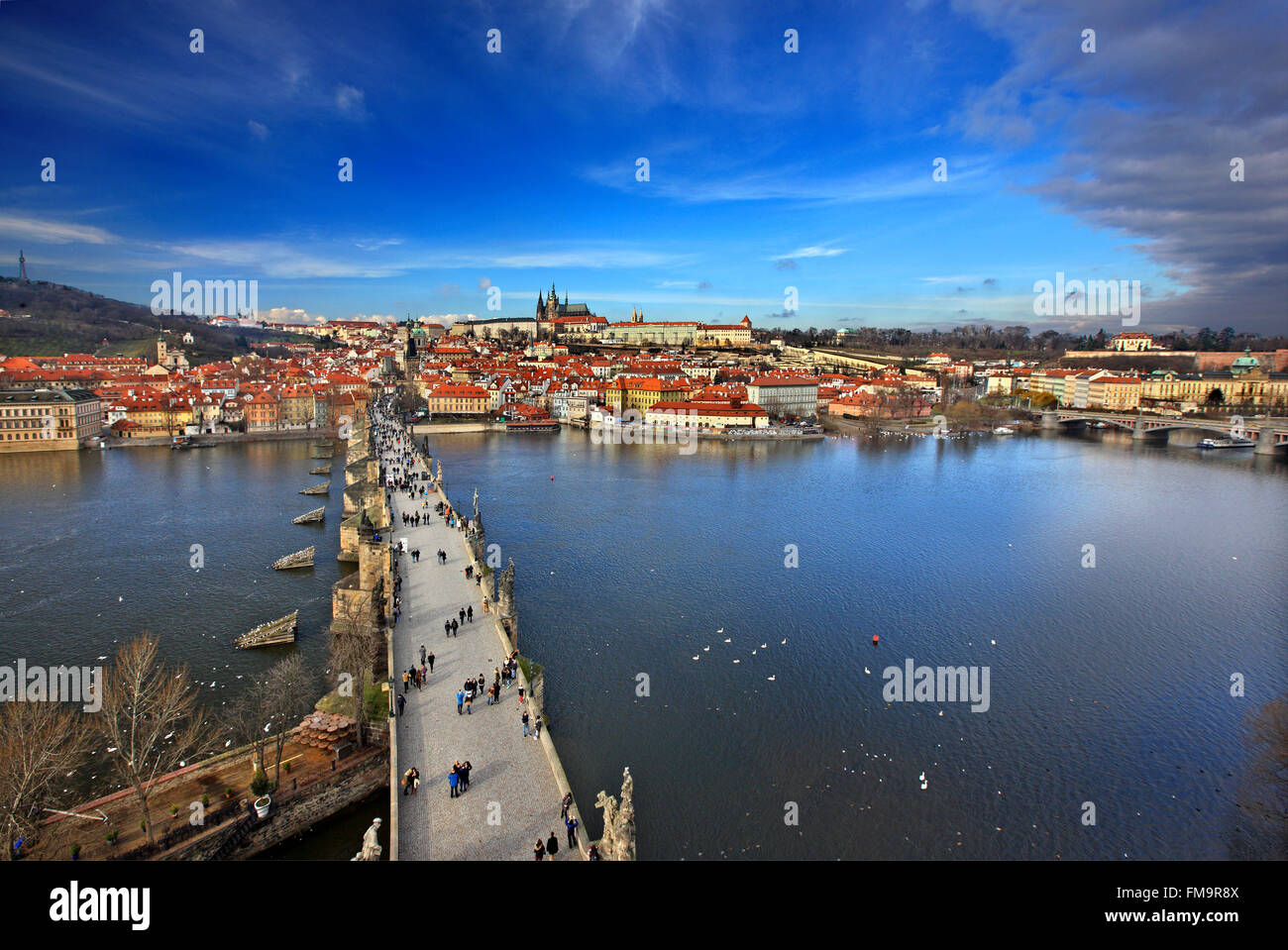 Charles' Bridge, Vltava river, Mala Strana and Prague Castle. View from one of the Towers of the bridge - Stock Image