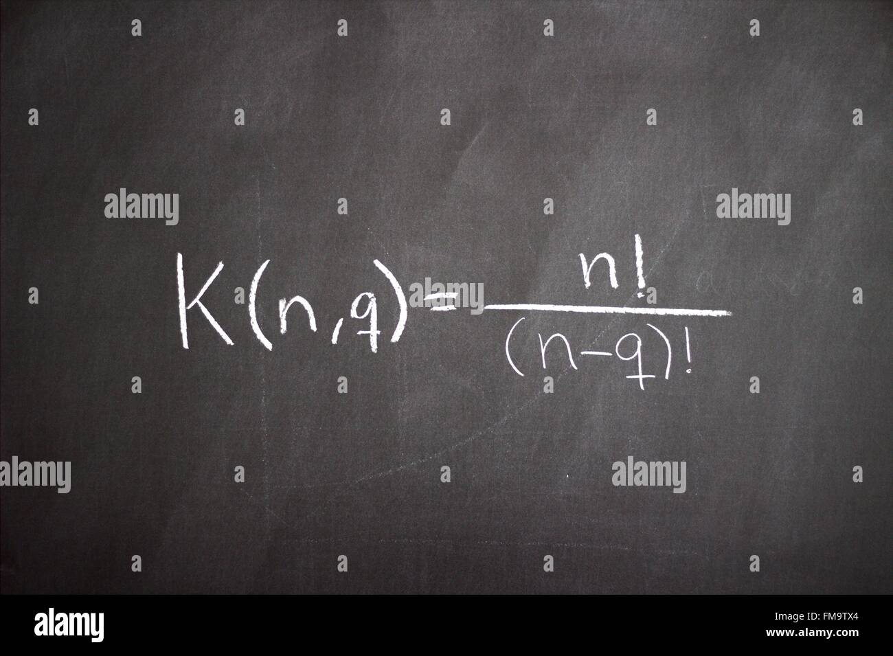 Studying the science of mathematics and economics on a blackboard - Stock Image