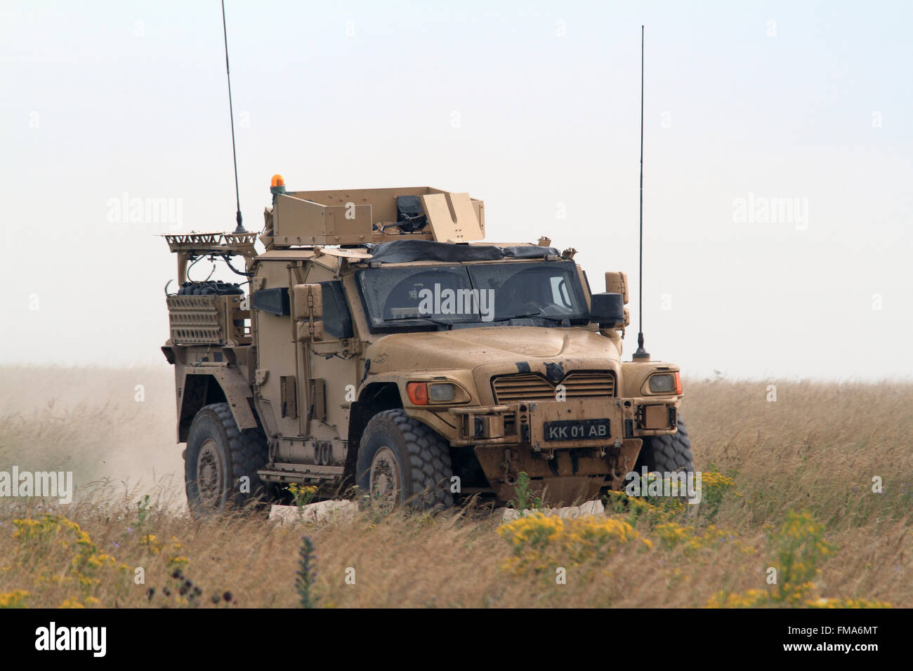 British Army Husky Protected Support Vehicle Traveling Over Rough Stock Photo Alamy