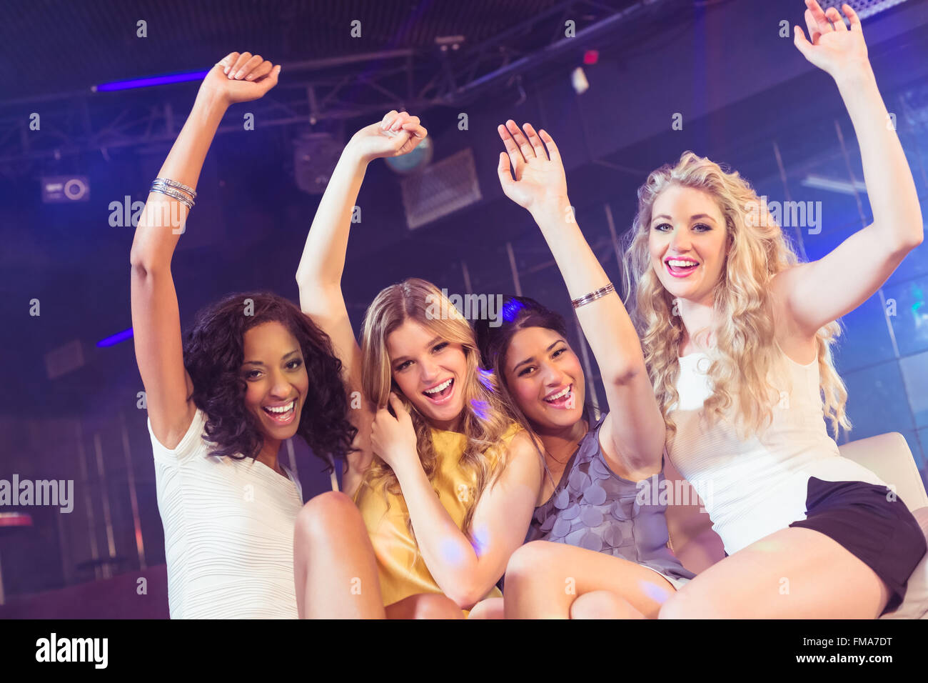 Pretty girls with arms up - Stock Image