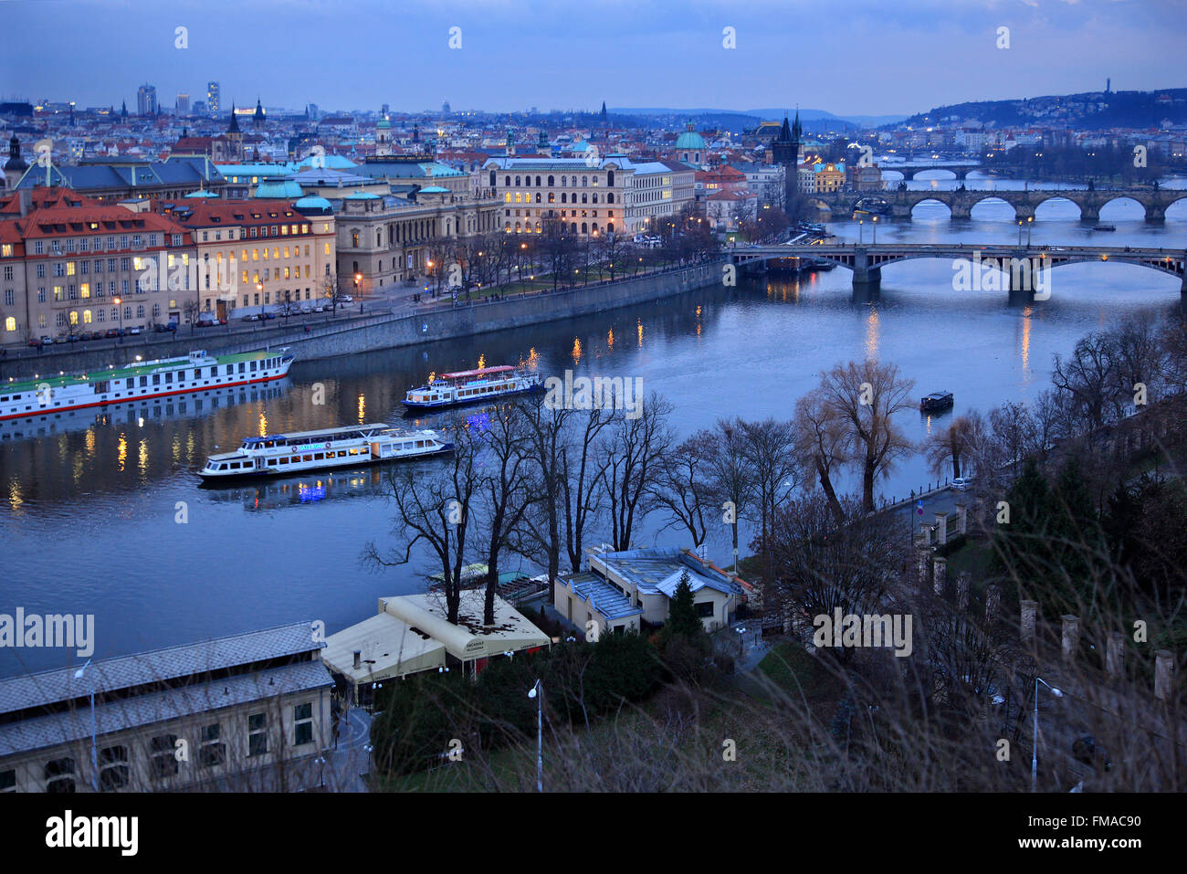 Riverboats and bridges on Vltava (Moldava), river, Prague, Czech Republic. The one in the middle is the famous Charles' - Stock Image