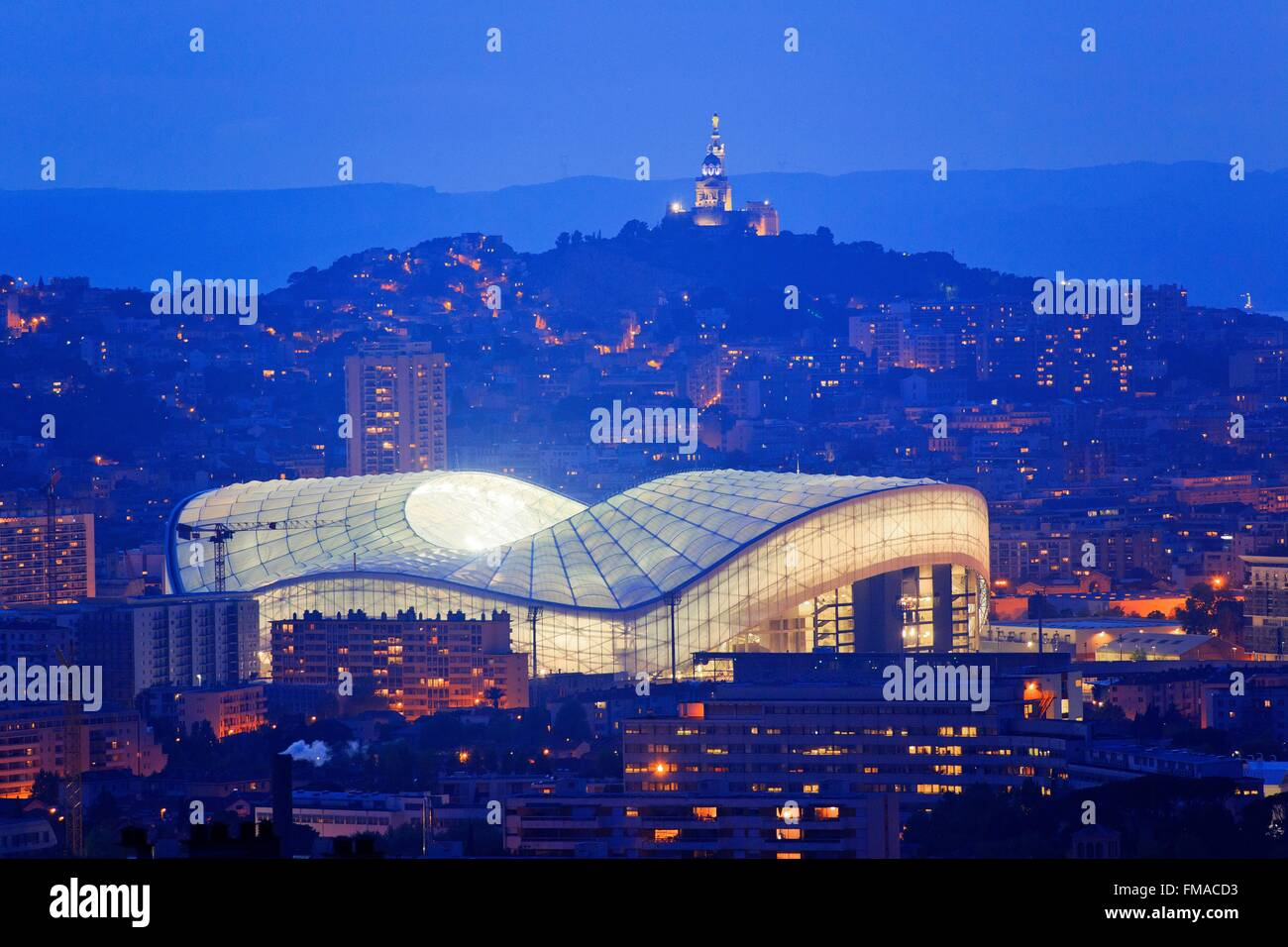 France, Bouches du Rhone , Marseille, the Velodrome stadium and the Notre Dame de La Garde background - Stock Image