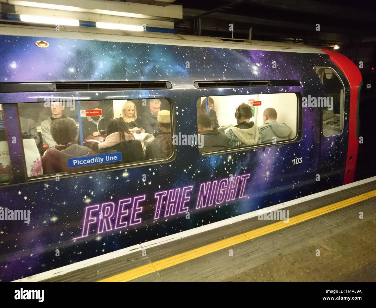 TFL (Transport for London) promotes Night tube service on Piccadilly line in London Underground, London, UK, 8 December - Stock Image