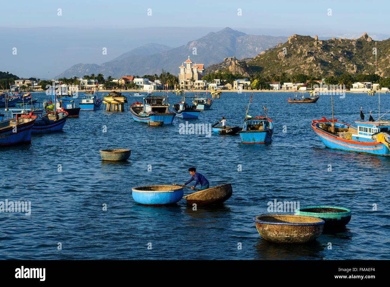Vietnam, Ninh Thuan province, Phan Rang, the fishing port with the church in the background - Stock Image