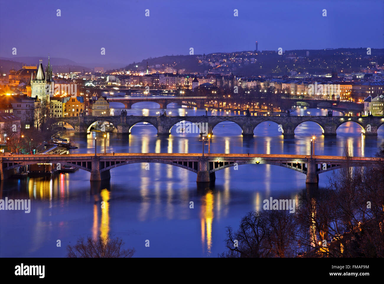 Bridges on Vltava (Moldava), river, Prague, Czech Republic. The one in the middle is the famous Charles' bridge. - Stock Image