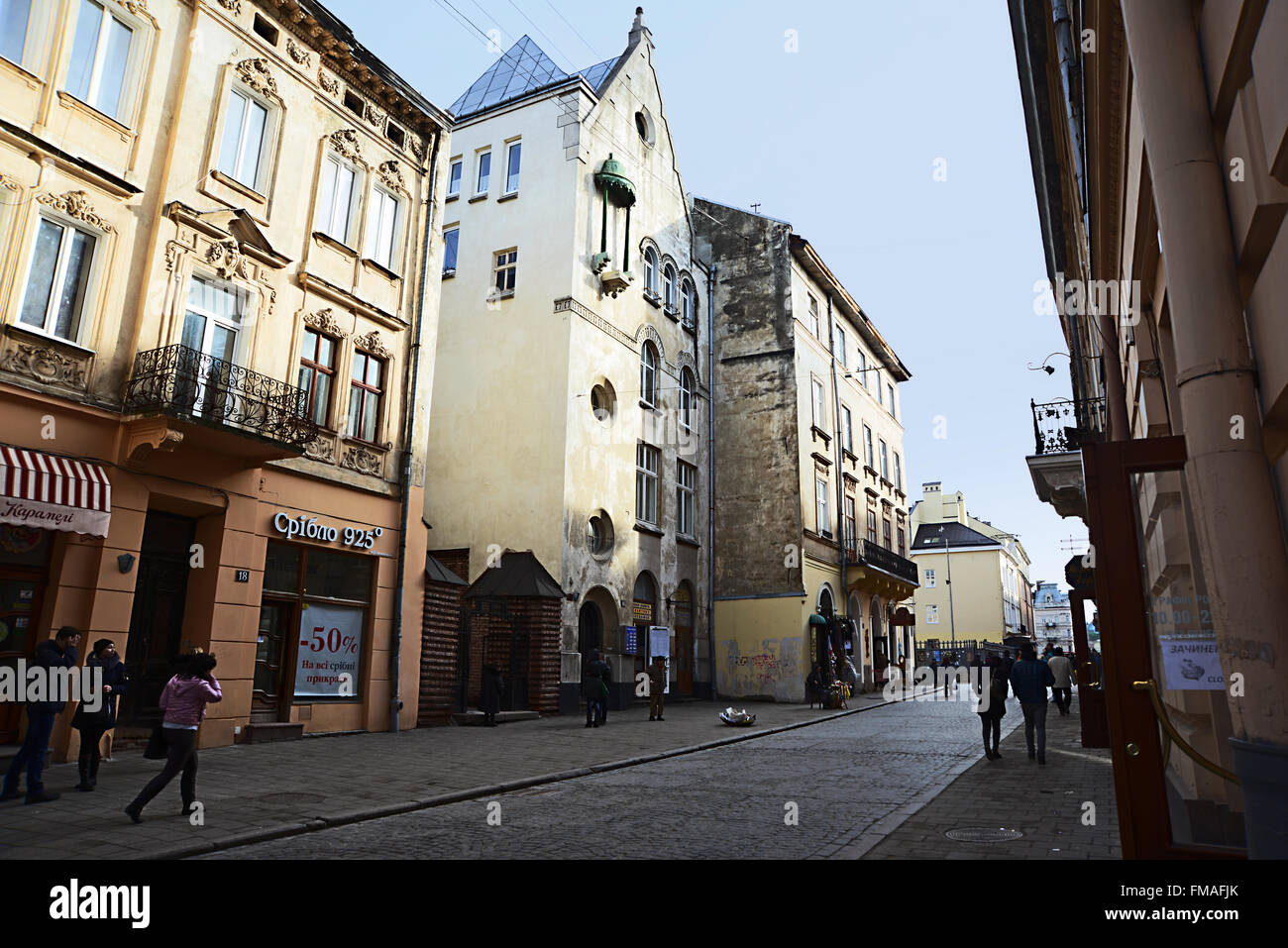 Lviv, Ukraine - January 30, 2016: Lviv cityscape. View of old street with the townspeople and tourists - Stock Image