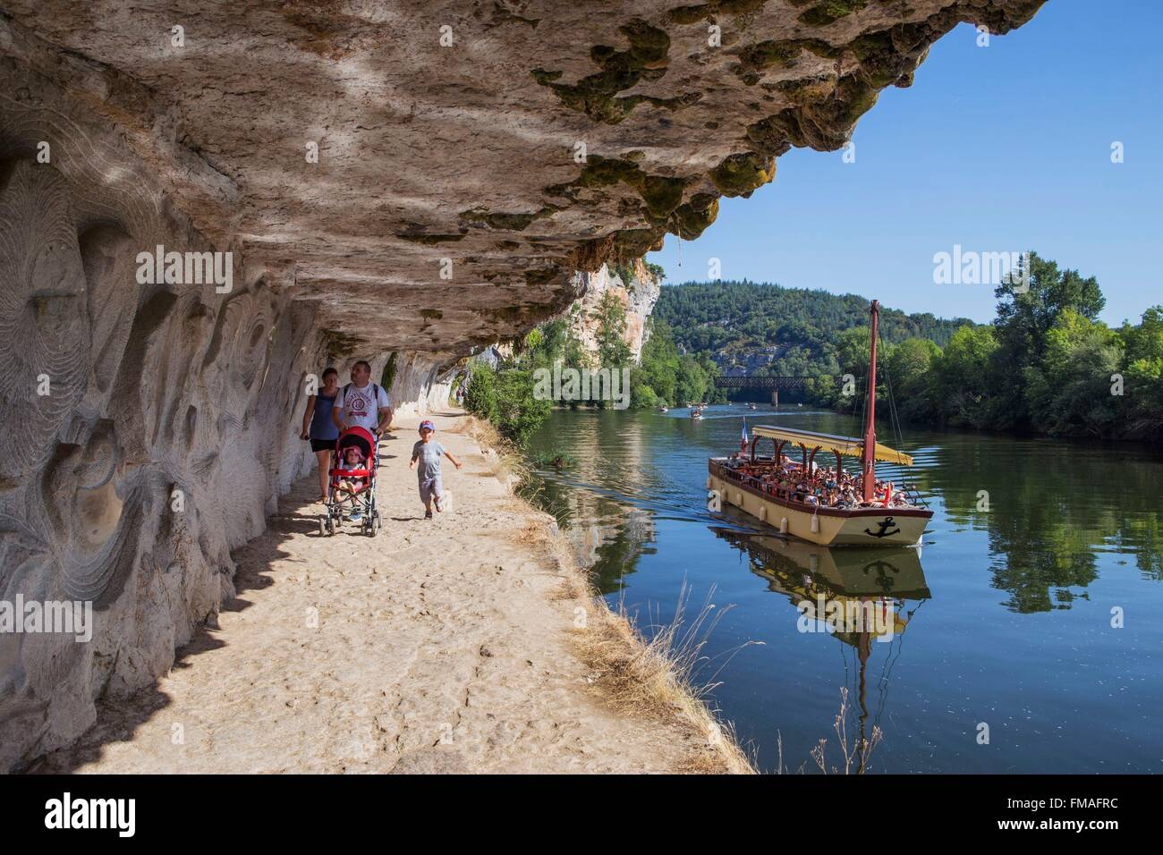 France, Lot, between Saint Cirq Lapopie and Bouzies, the Ganil towpath along the Lot river and the bas relief by - Stock Image