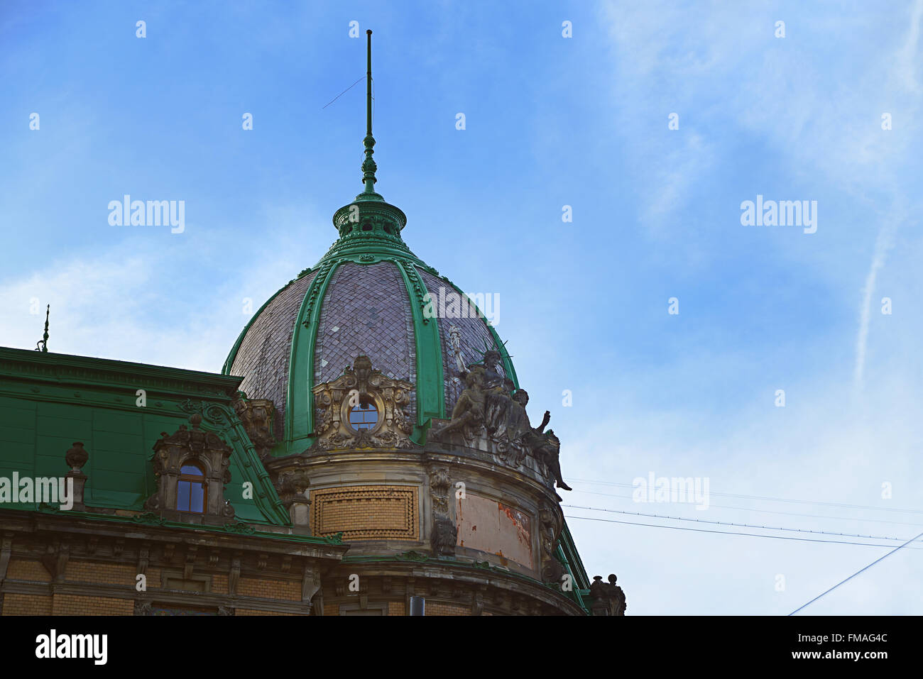 Lviv, Ukraine - January 30, 2016: View of The Sitting Statue of Liberty on the roof of the Museum of Ethnography - Stock Image