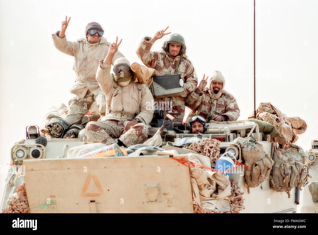 Saudi Arabian soldiers flash the victory sign during clean up operations following the Battle of Khafji February - Stock Image