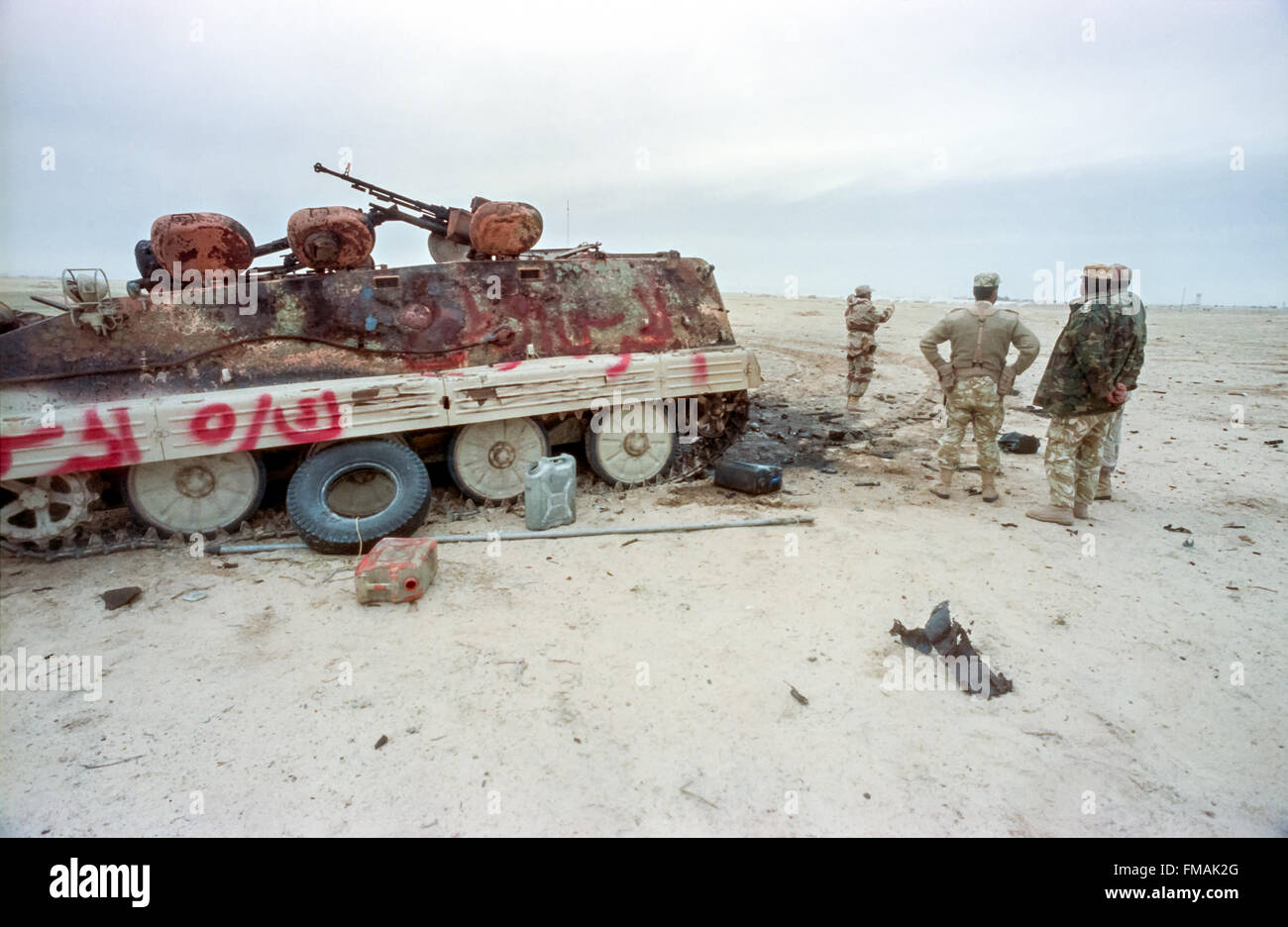 Qatar soldiers examine destroyed Iraqi armored personnel carriers destroyed by U.S Forces during the Battle of Khafji - Stock Image
