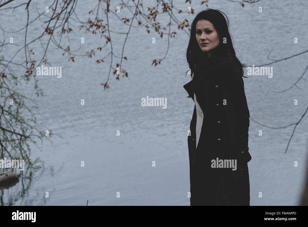 Girl walk alone melancholic mood - Stock Image
