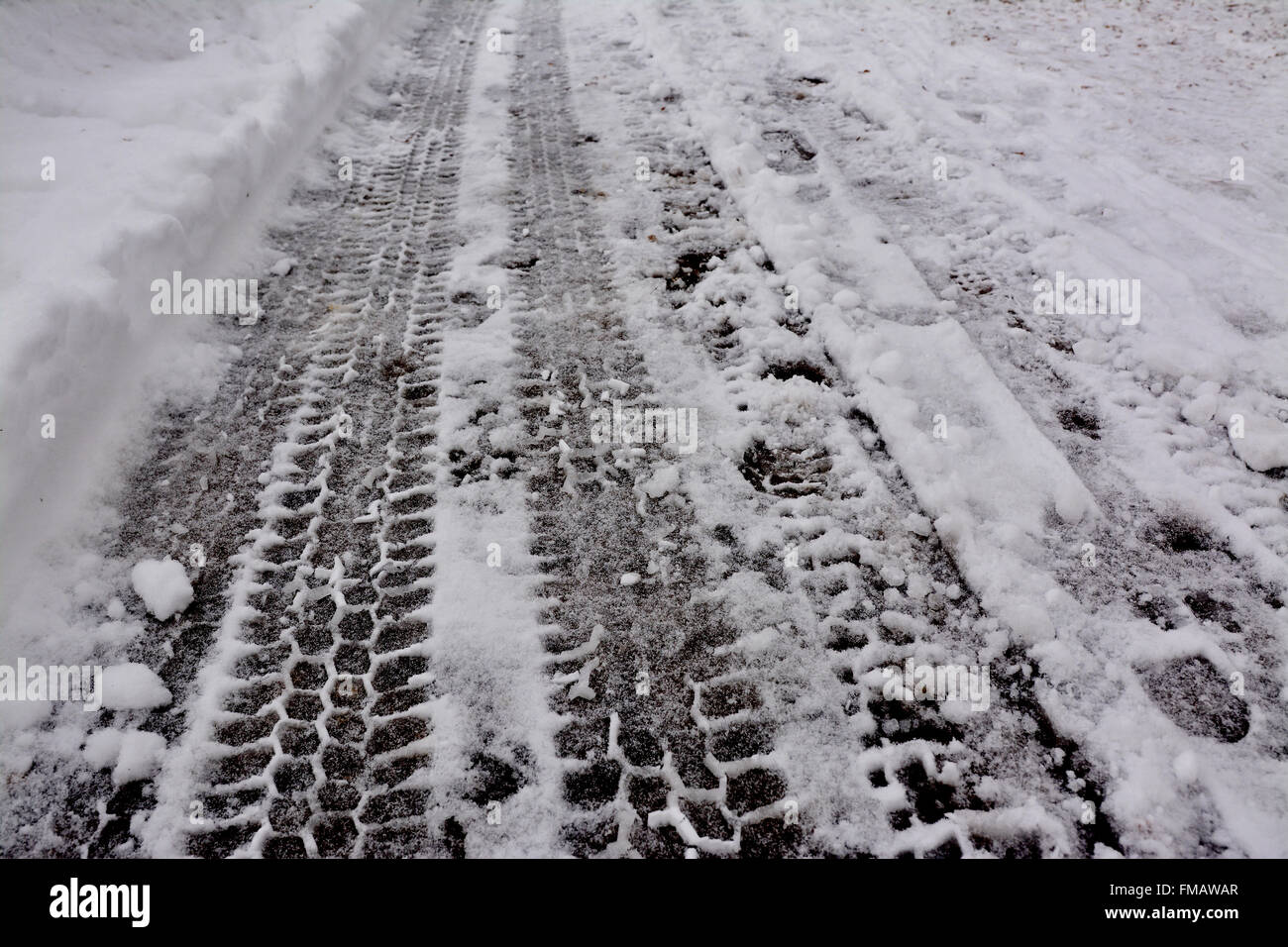Tire tracks on snow in winter. - Stock Image