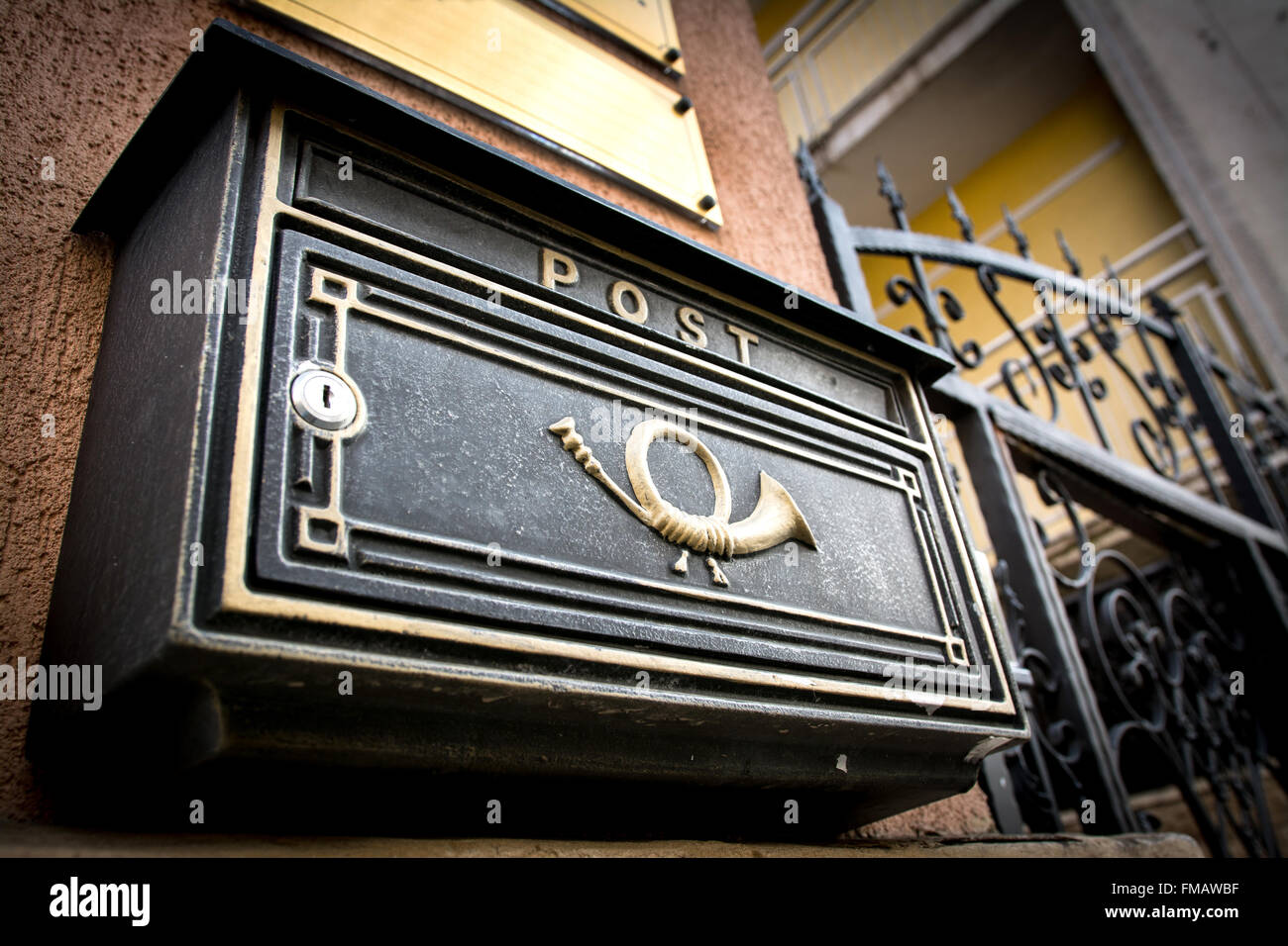 Black vintage mailbox with post written on it. - Stock Image