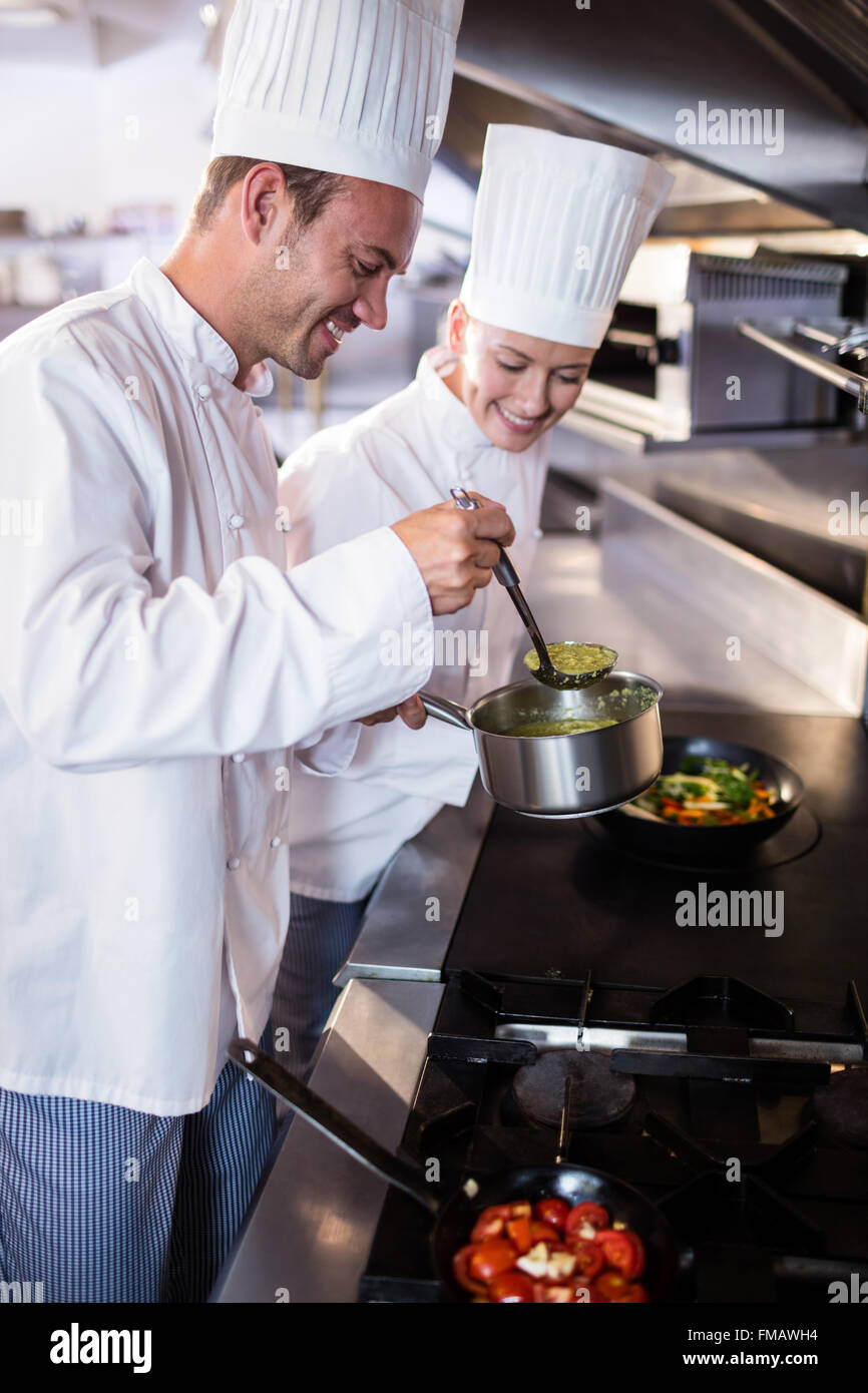 Chef preparing food in the kitchen - Stock Image