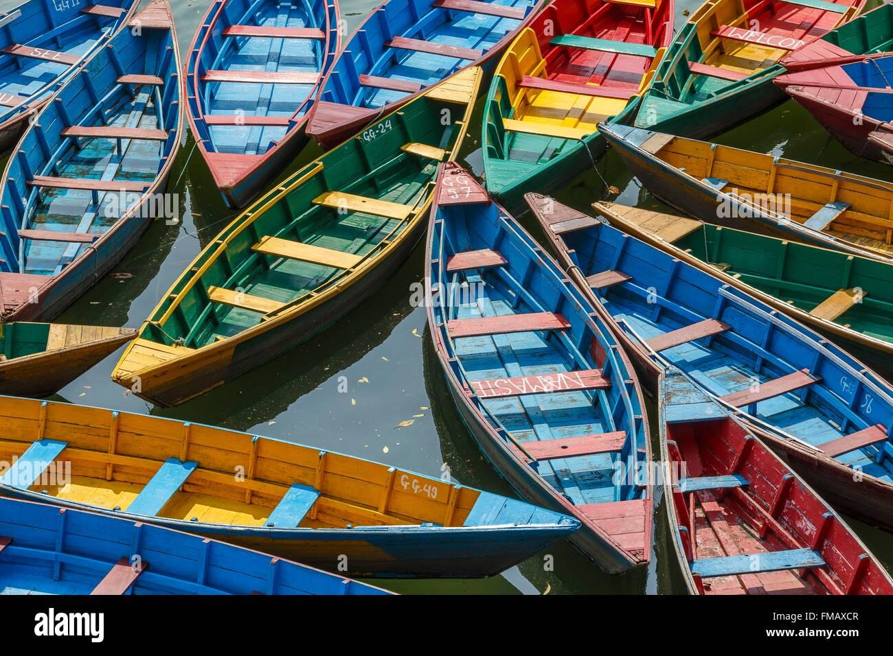 Nepal, Gandaki zone, Pokhara, colored boats on the Phewa lake - Stock Image